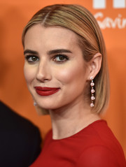 Emma Roberts matched her outfit with a swipe of bold red lipstick.