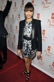Rashida combines some super stylish pieces with this leather belt and leopard print dress ensemble.