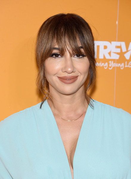 Jackie Cruz styled her hair into a chignon with eye-grazing bangs for TrevorLIVE NYC 2017.