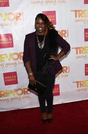 Alex Newell accessorized with a black fur stole for a more glamorous finish.