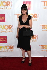 Pauley Perrette paired her LBD with a vintage-chic black tote.