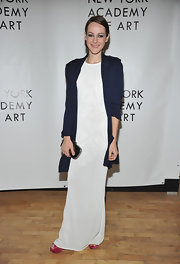 Jena Malone has been wearing a wide variety of red carpet looks this season. For the Tribeca Ball the actress donned a floor length white knit dress with an oversized navy blazer. She added a pop of color with a peek at her bright pink Casadei platforms.