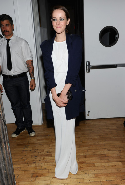 Jena donned an over-sized navy blazer with her white evening dress for this unique combination.