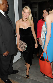 Naomi Watts carried this faux python Grace clutch to the Tribeca Ball in NYC.