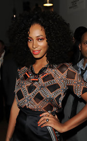 Solange Knowles went for lots of bold orange accents at the 2012 Tribeca Ball. She opted for a statement necklace, shimmering eyeshadow and opaque nail polish, all in the bright citrus shade.