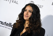 Salma Hayek framed her face with thick curls for the Tribeca Film Fest premiere of '11th Hour.'