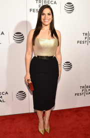 America Ferrera cut a shapely silhouette in a fitted gold and black strapless dress by Romona Keveza during the 'Special Correspondents' premiere.