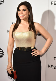 America Ferrera's gold box clutch and two-tone strapless dress at the 'Special Correspondents' premiere were a very stylish pairing!