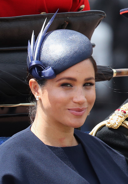 Meghan Markle accessorized with a blue decorative hat by Noel Stewart at the Trooping the Colour 2019.