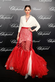 Araya A. Hargate attended the Trophee Chopard photocall during Cannes wearing a white wrap top by Jean Paul Gaultier Couture.