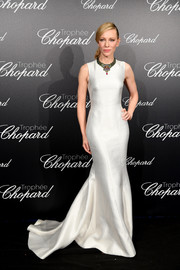 Cate Blanchett was the picture of elegance in a sleek white fishtail gown by Armani at the Trophee Chopard photocall during Cannes.