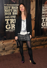 Jill Hennessy hopped aboard the purple pump trend in a pair of velvet eggplant colored pumps with wooden heels.