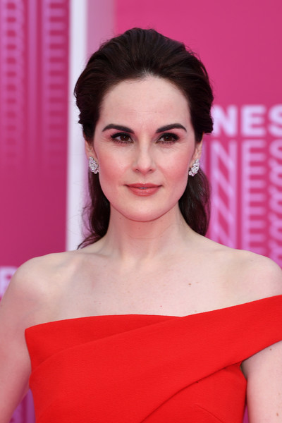 Michelle Dockery attended the Cannes International Series Festival screening of 'The Truth About the Harry Quebert Affair' wearing this regal-looking half-up hairstyle.