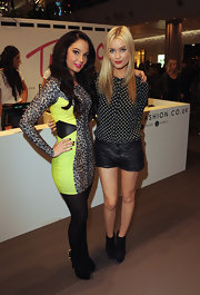 Laura Whitmore's black-and-white polka-dot blouse and leather shorts at the TFB by Tulisa launch were a super cute pairing.