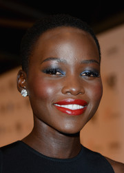 Lupita Nyong'o wasn't afraid of color, sporting bright blue eyeshadow at the London premiere of '12 Years a Slave.'