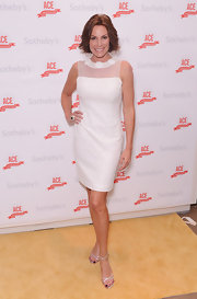 These delicate silver strappy sandals allowed LuAnn's stunning white dress to shine.