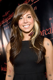 Side-swept bangs with shiny waves was Christina's hairstyle of choice for the 'Breaking Dawn' Concert Tour in Chicago.