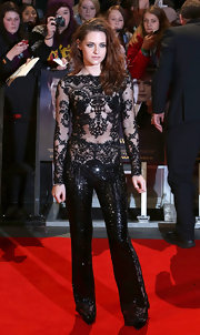 Talk about fierce style! Kristen Stewart was a knockout at the London premiere of 'Breaking Dawn - Party 2' in this black sequined lace jumpsuit.
