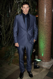 Kellan wore a tailored, navy suit with a midnight blue shirt and a striped, narrow tie.