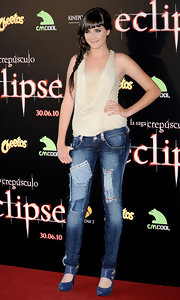 Lucia wore patch-detailed skinny jeans with suede pumps and a draped halter top.