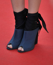 Marion Cotillard walked out in Dior peep toe wedges with ribbon wrap detailing for the 67th Annual Cannes Film Festival premiere of 'Two Days, One Night'.