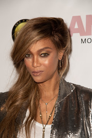 Tyra Banks sported a punk-glam side-swept 'do at the release of the 'America's Next Top Model' mobile game.