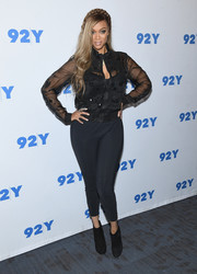 Tyra Banks promoted her book, 'Perfect is Boring,' wearing black leggings and a sheer zip-up jacket.