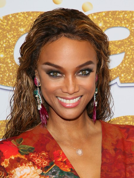 Tyra Banks Feathered Earring [hair,hairstyle,eyebrow,beauty,brown hair,amber,long hair,lip,ringlet,blond,red carpet,americas got talent,season,california,los angeles,tyra banks]