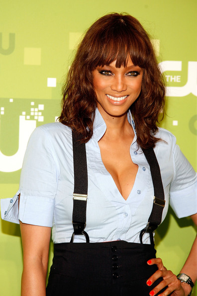 Tyra Banks Medium Curls with Bangs [hair,hairstyle,beauty,brown hair,bangs,layered hair,long hair,black hair,hair coloring,fashion accessory,tyra banks,upfront,jazz,new york city,lincoln center,cw network]