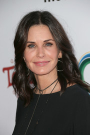 Courteney Cox styled her hair with feathery waves for the UCLA IOES celebration.