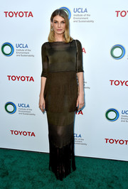 Angela Lindvall looked effortlessly elegant in a fringed brown column dress at the Innovators for a Healthy Planet event.