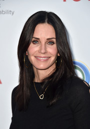 Courteney Cox was stylishly coiffed with this straight center-parted 'do at the Innovators for a Healthy Planet event.