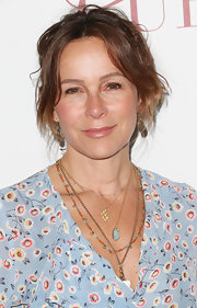 Jennifer Grey pulled her hair up in a messy updo with center-parted bangs for the Taste for a Cure fundraiser.