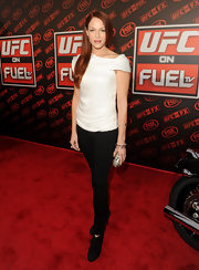 Amanda Righetti was a casual sophisticate in a white off-the-shoulder blouse and a pair of black skinny pants.