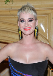 Katy Perry paired an orange lip with smoky pink eyeshadow for a vibrant beauty look.