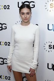 Delilah Belle Hamlin schooled us on sexy winter dressing with this super-short sweater dress at the UGG x SIX:02 holiday event.