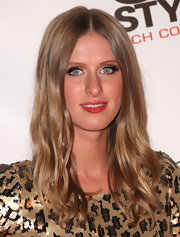 Nicky Hilton kept her look simple with a flushed cheek and cherry red lip gloss.