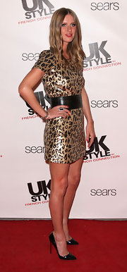 Nikcy paired her roaring leopard print dress with a Chelsea sterling silver and black onyx ring.