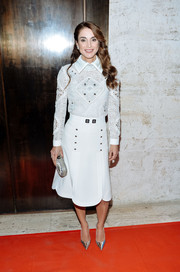 Silver pointy pumps polished off Queen Rania's look.