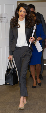 Amal Clooney accessorized with a black leather tote, also by Dolce & Gabbana.