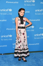 Millie Bobby Brown completed her ensemble with cute black glitter pumps.