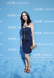 Eliza Dushku accessorized her look with an animal-print clutch.