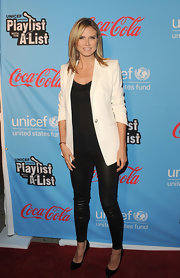 Heidi Klum rocked a pair of black leather stilettos along with sexy black leggings at the UNICEF Playlist With the A-List event.