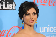 Morena Baccarin wore her hair in shiny tousled layers at the UNICEF Playlist With the A-List event.