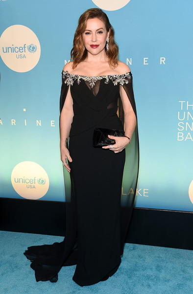 Alyssa Milano looked like royalty in an off-the-shoulder Pamella Roland gown with a bedazzled neckline and a watteau train at the 2018 UNICEF Snowflake Ball.