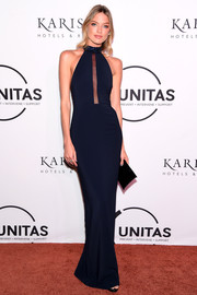 Martha Hunt was sleek and sultry in a navy halter gown with a peekaboo front during the UNITAS Gala Against Human Trafficking.