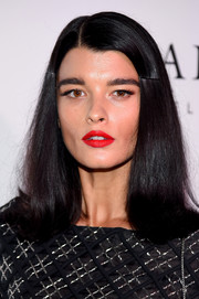 Crystal Renn's bright red lipstick looked striking against her dark hair and outfit.