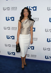 Gina Tores's nude satin one-shoulder top looked totally elegant and sophisticated on the actress.