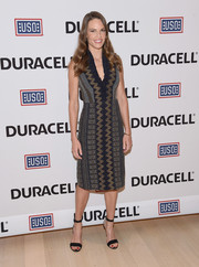 Hilary Swank showed off her shape in a fitted dress with metallic embroidery during the Comfort Crew for Military Kids event.