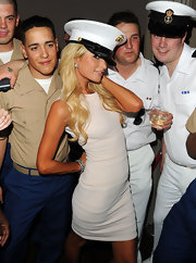 Paris borrowed a USO cap to pose with the troops. Cute!